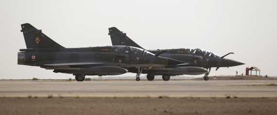 Two French army Mirage 2000 fighter jets prepare to take off on October 12, 2015, as the French Prime Minister and the Defence Minister visit an army base in Jordan where French army aircraft are based. French air strikes in Syria may have killed French jihadists, a source close to French Prime Minister Manuel Valls said, although the defence ministry said the information could not yet be confirmed. AFP PHOTO / KENZO TRIBOUILLARD